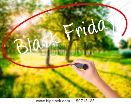 Woman Hand Writing Black Friday With A Marker Over Transparent Board