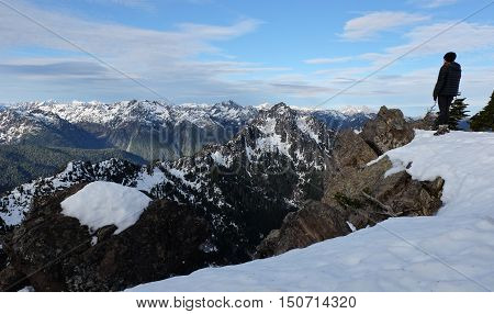 A Woman Hiker Stands on A Mountain Summit.  Mt Ellinor, Olympic National Park, Washington