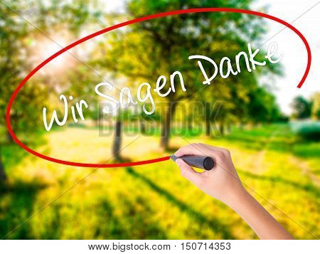 Woman Hand Writing Wir Sagen Danke (we Say Thank You In German)   With A Marker Over Transparent Boa