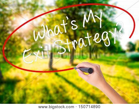 Woman Hand Writing What's My Exit Strategy? With A Marker Over Transparent Board