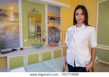 young beautiful professional cosmetician in modern salon.