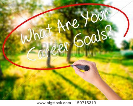 Woman Hand Writing What Are Your Career Goals? With A Marker Over Transparent Board