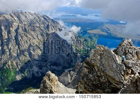 Woman Climber Ascending a Teton Peak.  Mt Teewinot, Grand Teton National Park, Wyoming