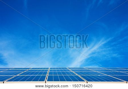 Solar panels with a nice cloudy blue sky