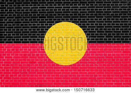 Australian Aboriginal official flag. Commonwealth of Australia patriotic symbol banner element background. Australian Aboriginal flag on brick wall texture, 3d illustration