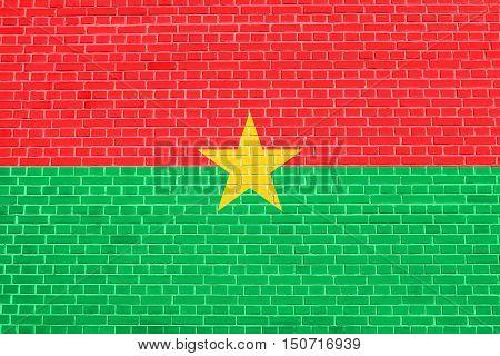 Burkina Faso national official flag. African patriotic symbol banner element background. Flag of Burkina Faso on brick wall texture background, 3d illustration