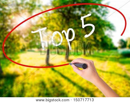 Woman Hand Writing Top 5 With A Marker Over Transparent Board