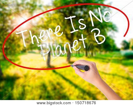 Woman Hand Writing There Is No Planet B With A Marker Over Transparent Board