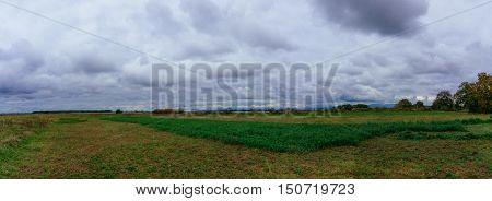 Storm Clouds over prairie field sky field storm clouds