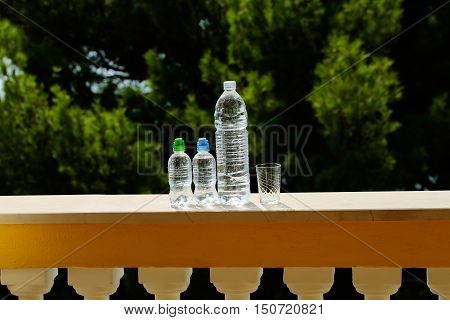 Three Plastic Bottles And Glass
