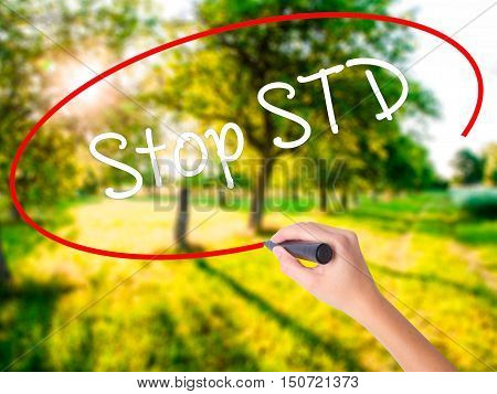 Woman Hand Writing Stop Std (sexually Transmitted Diseases) With A Marker Over Transparent Board