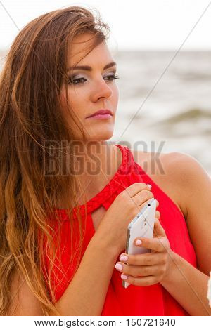 Woman With Phone Sends Sms.