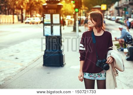 Travel Europe. Young stylish woman on the Background of European City Street of Budapest Hungary. Holidays in European City. Lifestyle and Travel Concept.