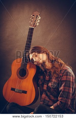 Languorous Young Man With Instrument.