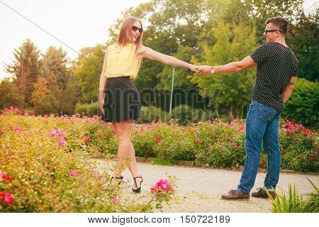 Happy Couple Around Flowers