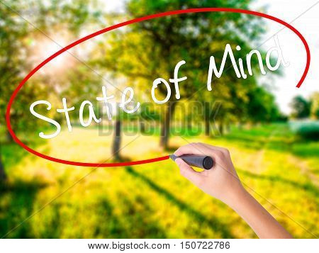 Woman Hand Writing State Of Mind  With A Marker Over Transparent Board