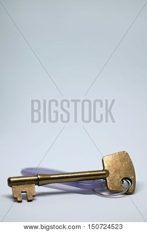 Key on a tag against an isolated background