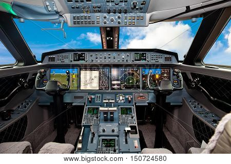 The cockpit of the aircraft with blue sky outside