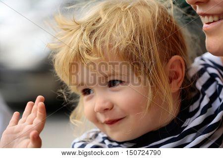 Baby Boy Waves Hand