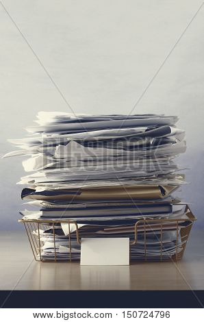 Wire Office Tray Piled Up With Papers