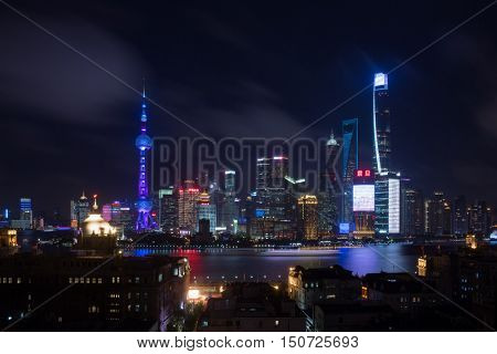 SHANGHAI - AUG 11, 2015: TV tower Oriental Pearl with illumination at night, Tower third highest in Asia