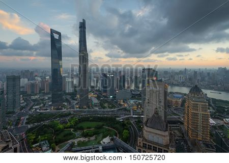 SHANGHAI - AUG 13, 2015: Jin Mao Tower, Shanghai tower, Shanghai World Financial Center at evening, view from IFC hotel, 990 skyscrapers are in Shanghai