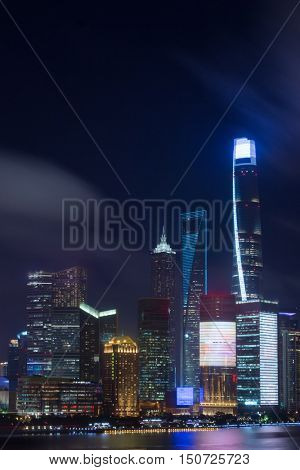 SHANGHAI - AUG 11, 2015: River, Shanghai Tower and Shanghai World Financial Center at night, Shanghai has population of 24,6 millions people