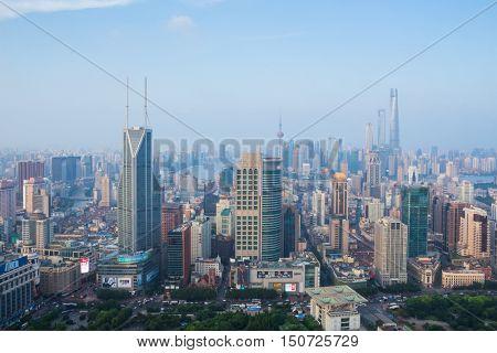SHANGHAI - AUG 7, 2015: Shimao International Plaza among high buildings, 990 skyscrapers are in Shanghai