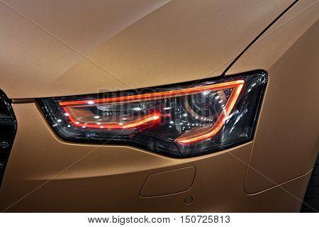 Modern car headlight lighting close up view