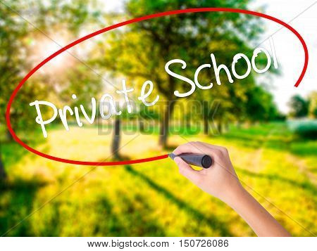 Woman Hand Writing  Private School With A Marker Over Transparent Board