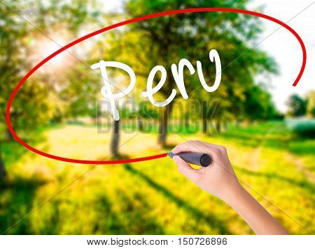 Woman Hand Writing Peru With A Marker Over Transparent Board