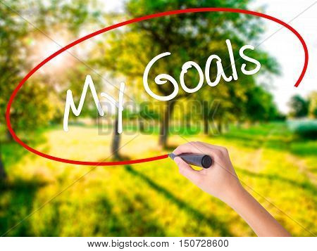 Woman Hand Writing  My Goals With A Marker Over Transparent Board