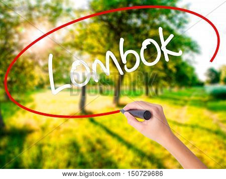 Woman Hand Writing Lombok  With A Marker Over Transparent Board