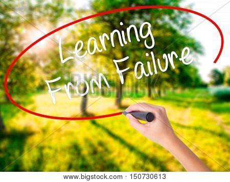 Woman Hand Writing Learning From Failure With A Marker Over Transparent Board .