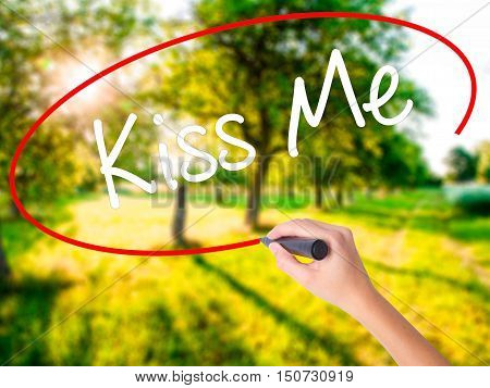 Woman Hand Writing Kiss Me With A Marker Over Transparent Board