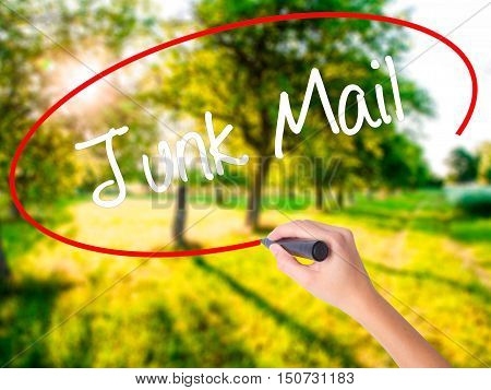 Woman Hand Writing Junk Mail With A Marker Over Transparent Board