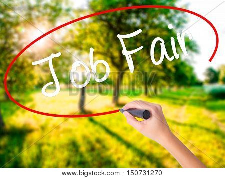 Woman Hand Writing Job Fair With A Marker Over Transparent Board