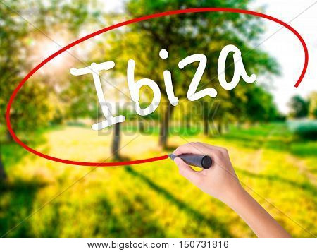 Woman Hand Writing Ibiza With A Marker Over Transparent Board