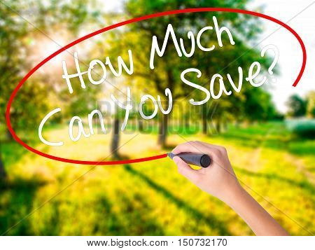 Woman Hand Writing How Much Can You Save? With A Marker Over Transparent Board