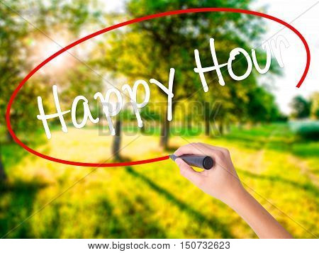 Woman Hand Writing Happy Hour With A Marker Over Transparent Board