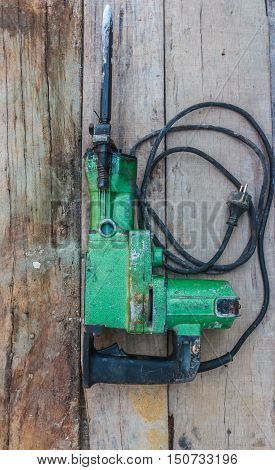 Electric hammer Plugger. on the old wood