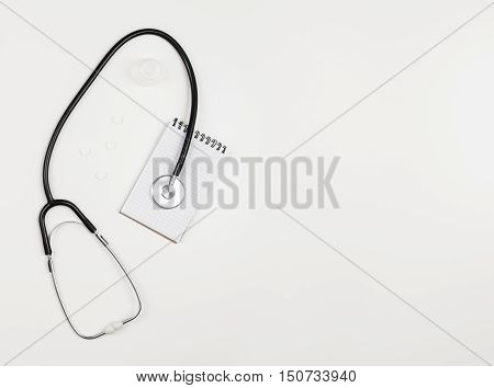 Top view of modern, sterile doctors office desk. Medical accessories on a white background with copy space around products. Photo taken from above.