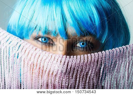 Man In Blue Wig Behind The Scarf