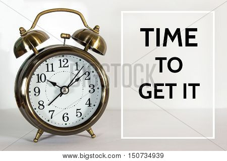 Time to get it, message on the clock background / Time concept