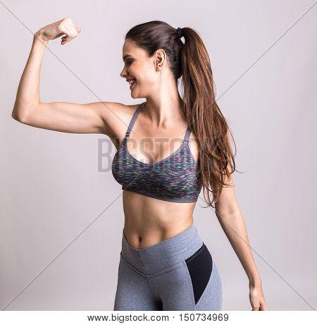 Young latina woman showing her beautiful arm