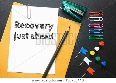 Text recovery just ahead on white paper background / business concept