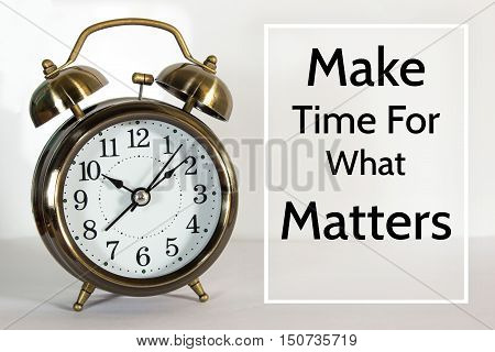 Make time for what matters, message on the clock background / Time concept
