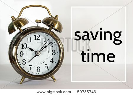 saving time, message on the clock background / Time concept