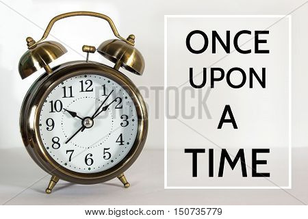 Once upon a time, message on the clock background / Time concept