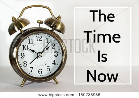 Text The time is now on clock background / time concept